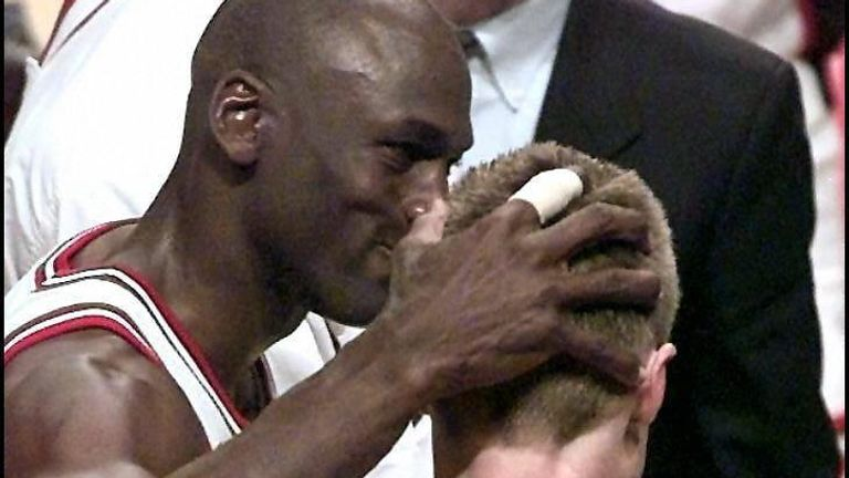 Michael Jordan congratulates teammate Steve Kerr after Kerr's last-second basket against the Utah Jazz in game six of the 1997 NBA Finals