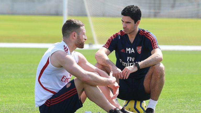 Shkodran Mustafi of Arsenal chats to Arsenal Head Coach Mikel Arteta during the Arsenal Training Session on February 08, 2020 in Dubai, United Arab Emirates.