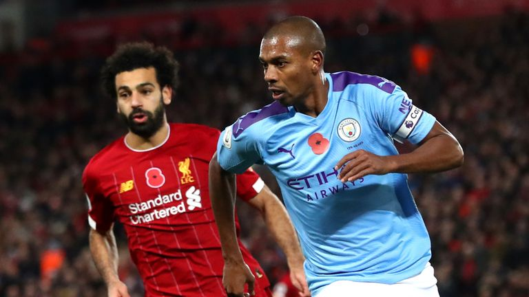 Mohamed Salah and Fernandinho in action during Liverpool's 3-1 win against Manchester City in November