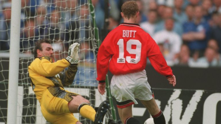 Neville Southall saves smartly at the feet of Nicky Butt as Everton held on