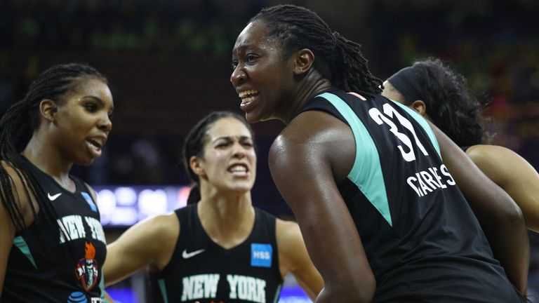 New York Liberty players celebrate a basket against the Seattle Storm