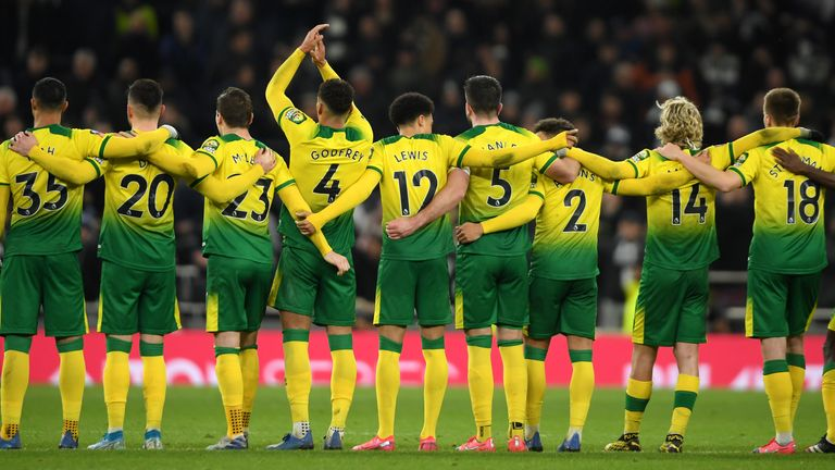 Norwich's players gather ahead of their penalty shootout against Tottenham in the FA Cup.