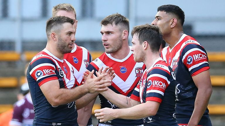 SYDNEY, AUSTRALIA - MARCH 21: Daniel Tupou of the Roosters celebrates with teammates after scoring a try during the round 2 NRL match between the Sydney Roosters and the Manly Sea Eagles at Leichhardt Oval on March 21, 2020 in Sydney, Australia. (Photo by Jason McCawley/Getty Images)