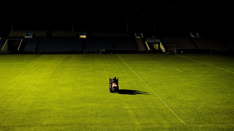 Semple Stadium groundsman and former Tipperary hurler Pa Bourke works on the field at 10PM on a Saturday night after the 2015 All-Ireland Football Championship qualifier between Kildare and Cork
