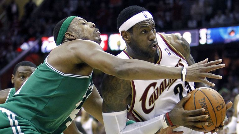 LeBron James drives by Paul Pierce during a Cavaliers-Celtics game