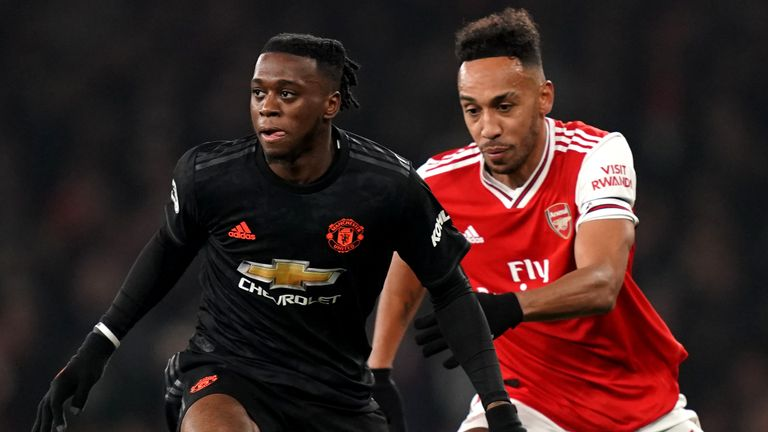 Manchester United's Aaron Wan-Bissaka (left) and Arsenal's Pierre-Emerick Aubameyang battle for the ball during the Premier League match at the Emirates Stadium, London.