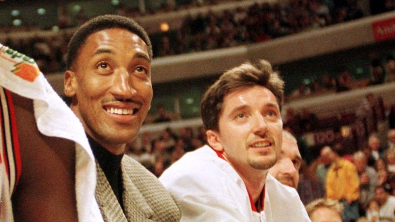 Chicago Bulls injured forward Scottie Pippen and forward Toni Kukoc watch their teammates play against the Milwaukee Bucks