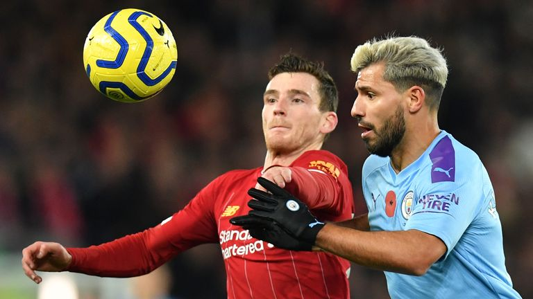 Andy Robertson and Sergio Aguero compete for the ball
