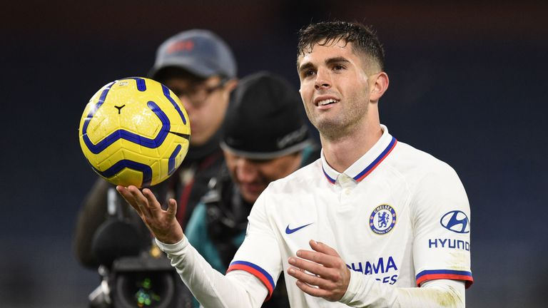 hristian Pulisic leaves the pitch holding the match ball after scoring a hattrick to help his team to a 2-4 victory during the English Premier League football match between Burnley and Chelsea at Turf Moor in Burnley, north west England on October 26, 2019
