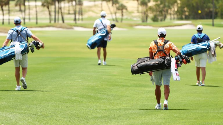 The players carried their own bags throughout the event