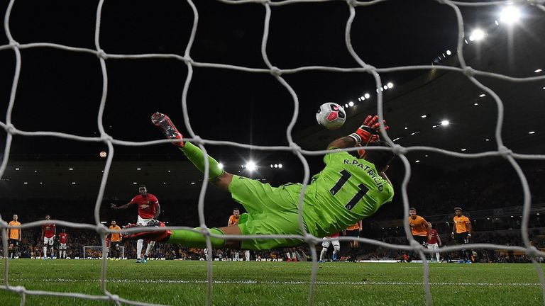 Rui Patricio of Wolves saves a penalty from Paul Pogba of Manchester United at Molineux
