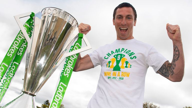 Scott Brown poses alongside the Ladbrokes Premiership trophy after Celtic are confirmed as champions