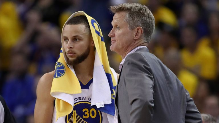 Stephen Curry and Steve Kerr share an exchange during the NBA Finals