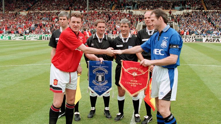 Manchester United captain Steve Bruce greets Dave Watson at the coin toss