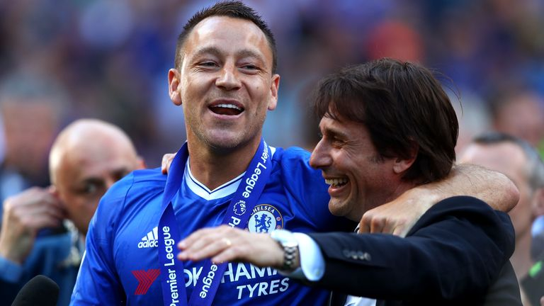 Antonio Conte and John Terry celebrate following the Premier League match between Chelsea and Sunderland at Stamford Bridge on May 21, 2017 in London, England.
