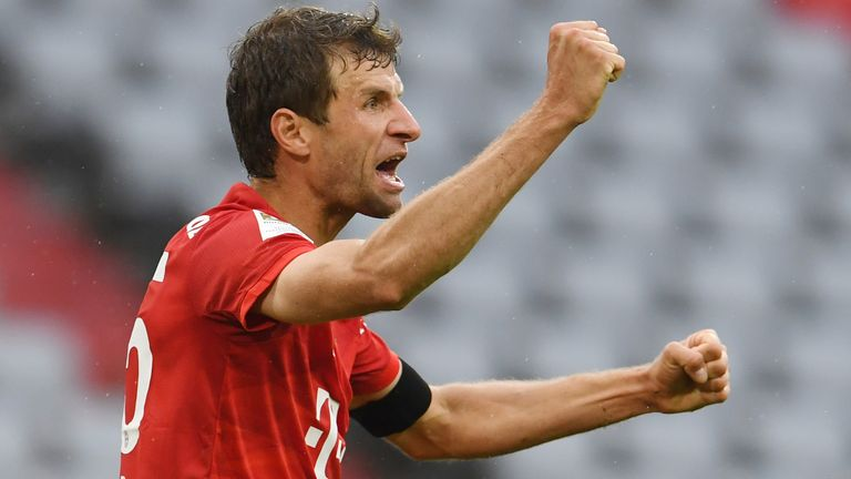 Thomas Muller celebrates scoring Bayern Munich's second goal against Frankfurt
