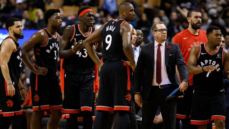 Nick Nurse pictured with his Raptors players during a timeout
