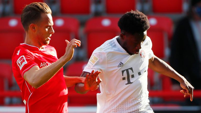 FC Union Berlin's Marcus Ingvartsen in action with Bayern Munich's Alphonso Davies