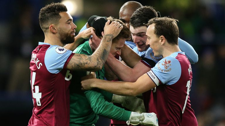 David Martin is congratulated by his West Ham team-mates at Stamford Bridge