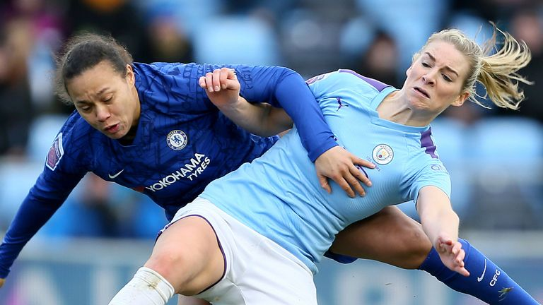 Chelsea's Drew Spence and Man City defender Gemma Bonner battle for the ball