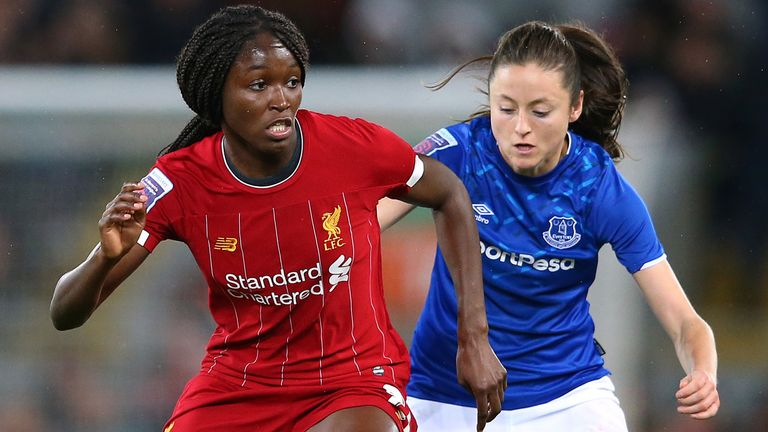 Liverpool's Rinsola Babajide holds off a challenge from Everton's Danielle Turner in the Women's Super League