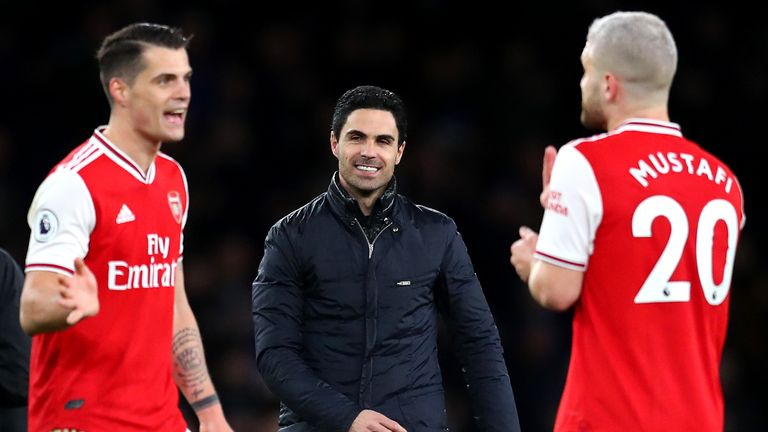 LONDON, ENGLAND - FEBRUARY 23: Mikel Arteta, Granit Xhaka and Shkodran Mustafi of Arsenal celebrate during the Premier League match between Arsenal FC and Everton FC at Emirates Stadium on February 23, 2020 in London, United Kingdom. (Photo by Catherine Ivill/Getty Images)