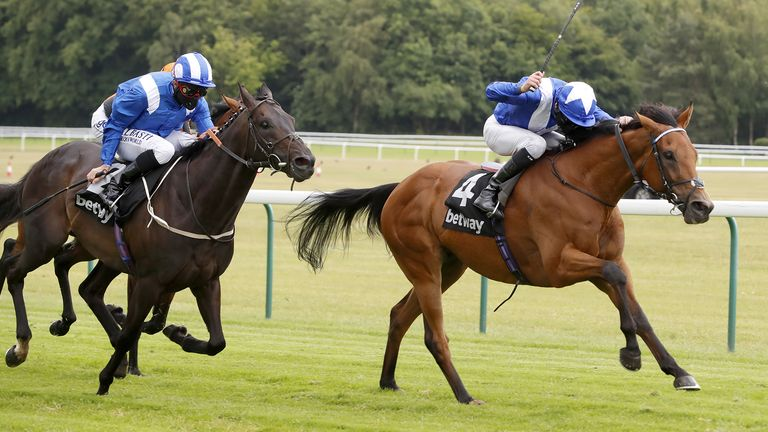 Lord North and Robert Havlin (right) from Elarqam (left) winning The Betway Brigadier Gerard Stakes at Haydock Racecourse.