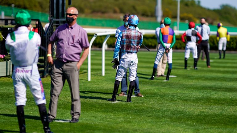 Social distancing in the parade ring by the jockeys at Newcastle