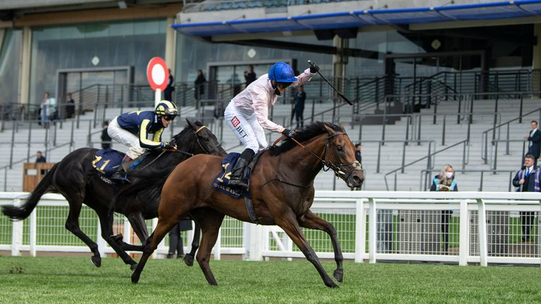 Onassis ridden by Hayley Turner (r) win the Sandringham Stakes