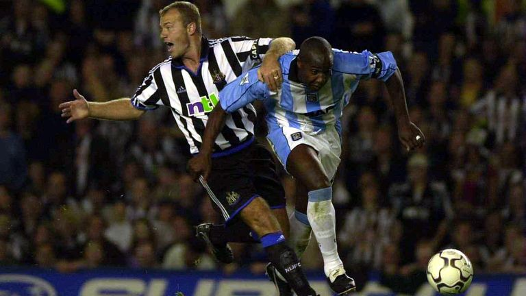 William shrugs off the attention of Newcastle's Alan Shearer