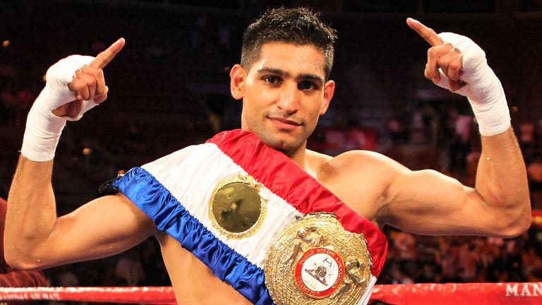 Khan unified two world super-lightweight titles during his career