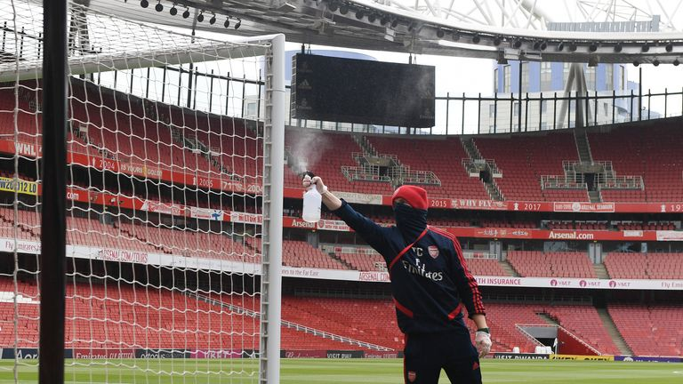 Arsenal groundstaff clean the goalpoasts before a friendly match between Arsenal and Charlton Athletic at Emirates Stadium on June 06, 2020 in London, England. (Photo by Stuart MacFarlane/Arsenal FC via Getty Images)
