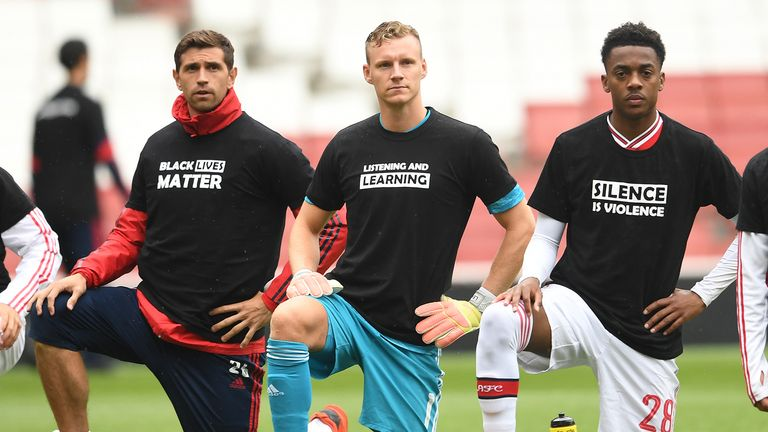 Emi Martinez, Bernd Leno and Joe Willock of Arsenal take a knee in support of Black Lives Matter before the friendly match between Arsenal and Brentford at Emirates Stadium on June 10, 2020 in London, England