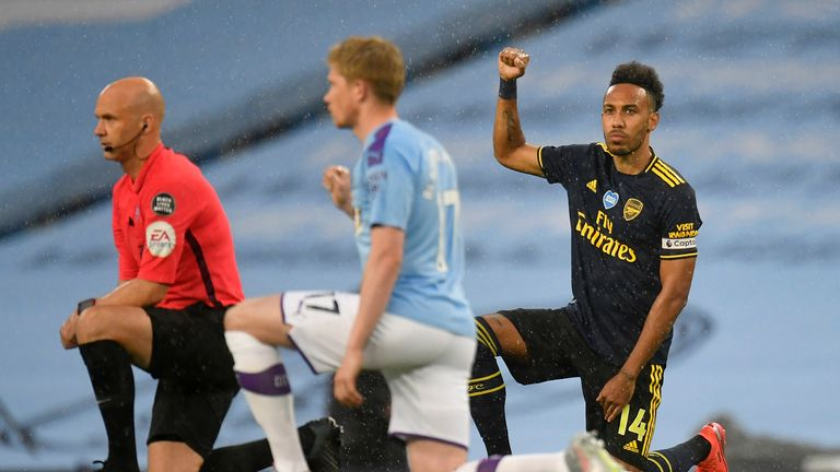 Pierre-Emerick Aubameyang of Arsenal takes a knee in support of the Black Lives Matter movement prior to the Premier League match between Manchester City and Arsenal FC at Etihad Stadium on June 17, 2020 in Manchester, United Kingdom.