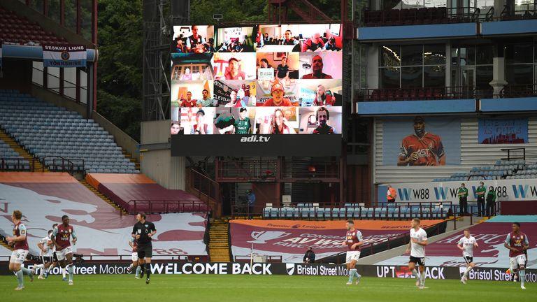 Aston Villa fans on the big screen at Villa Park