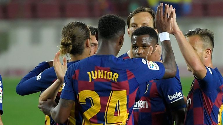 Barcelona's Guinea-Bissau forward Ansu Fati (2R) celebrates with teammates after scoring during the Spanish league football match FC Barcelona against CD Leganes at at the Camp Nou stadium in Barcelona on June 16, 2020. (Photo by LLUIS GENE / AFP) (Photo by LLUIS GENE/AFP via Getty Images)