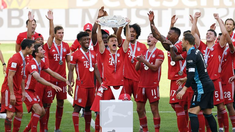 Bayern Munich lifted the Bundesliga trophy inside the empty Volkswagen Arena