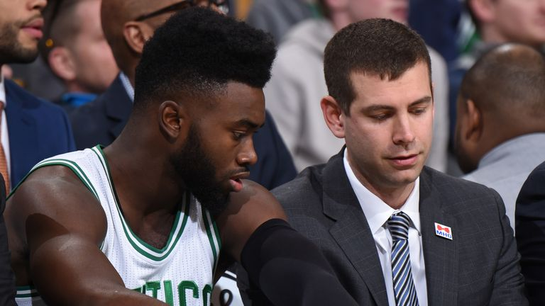 Brad Stevens discusses a play with Jaylen Brown on the Celtics bench