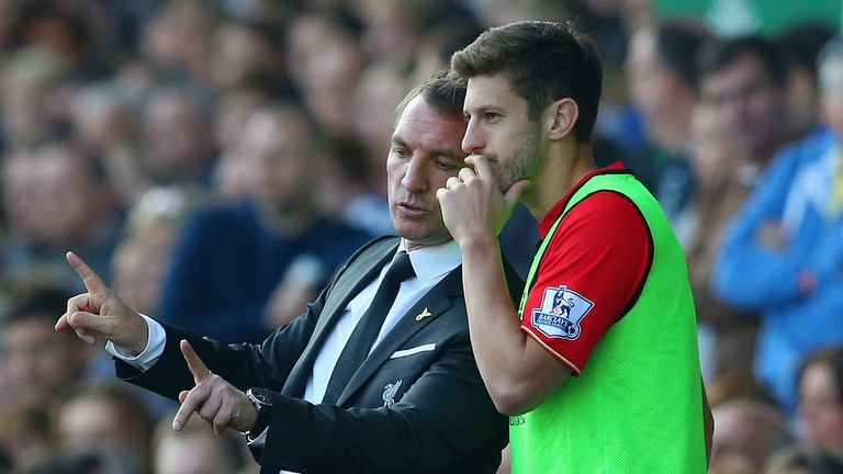 Adam Lallana and Brendan Rodgers during the Barclays Premier League match between Everton and Liverpool at Goodison Park on October 4, 2015 in Liverpool, England.