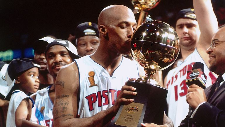 Chauncey Billups of the Detroit Pistons kisses his Most Valuable Player Trophy after Game Five of the 2004 NBA Finals