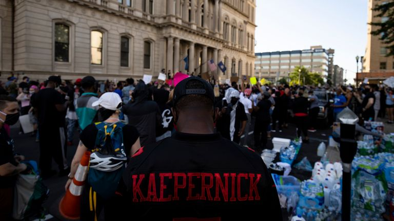 A protester wears a Kaepernick jersey outside city hall in Louisville, Kentucky in May 2020