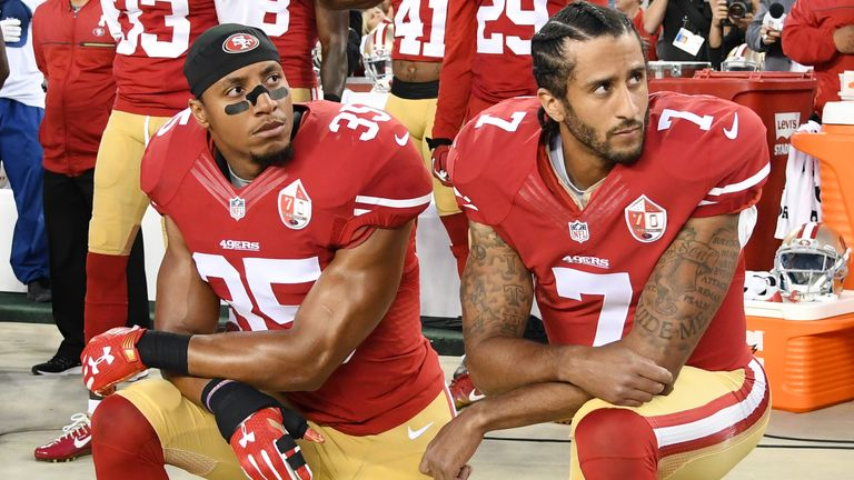 Athletes began to kneel during the US anthem in solidarity with Colin Kaepernick (right), who was one of the first high-profile athletes to protest in the NFL in 2016