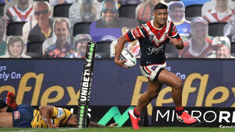 Daniel Tupou races clear to score for the Roosters