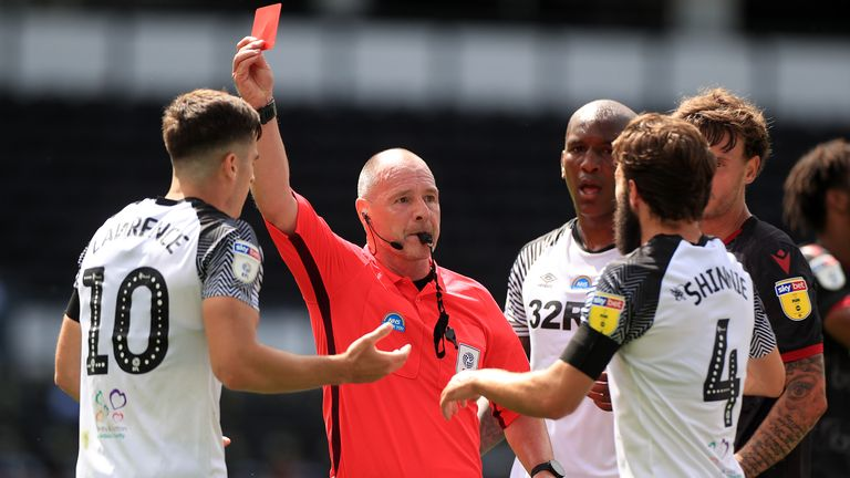 "Derby County's Tom Lawrence is shown a red card by referee Scott Duncan during the Sky Bet Championship match at Pride Park, Derby. PA Photo. Issue date: Saturday June 27, 2020. See PA story SOCCER Derby. Photo credit should read: Mike Egerton/PA Wire. RESTRICTIONS: EDITORIAL USE ONLY No use with unauthorised audio, video, data, fixture lists, club/league logos or ""live"" services. Online in-match use limited to 120 images, no video emulation. No use in betting, games or single club/league/player publications."