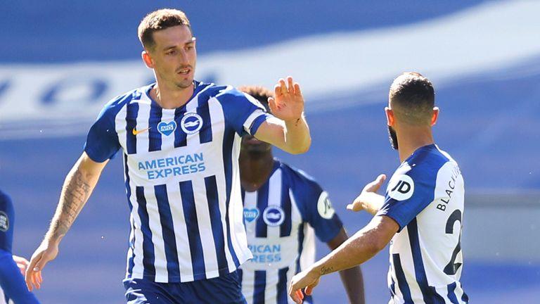 Lewis Dunk celebrates scoring Brighton's equaliser against Arsenal