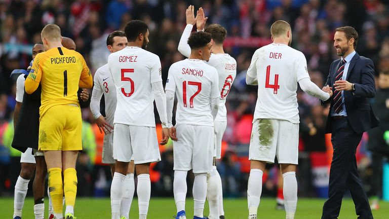 England players and manager Gareth Southgate celebrate after UEFA Nations League A group four win over Croatia at Wembley Stadium on November 18, 2018
