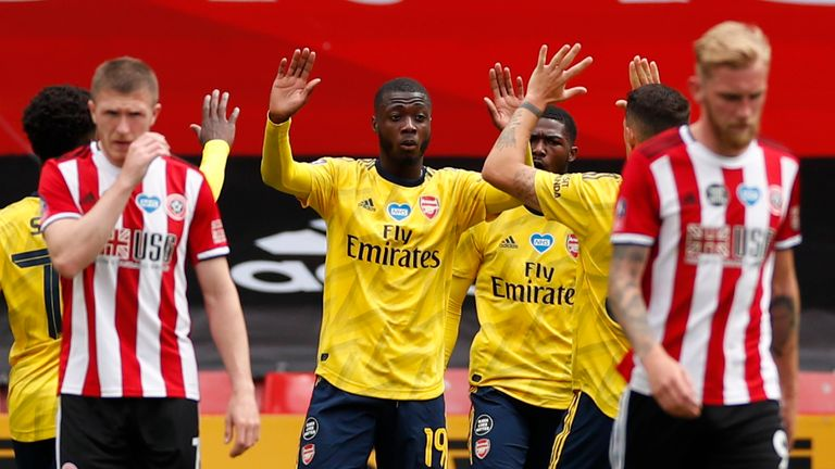 SHEFFIELD, ENGLAND - JUNE 28: Nicolas Pepe of Arsenal scores his sides first goal from the penalty spot during the FA Cup Fifth Quarter Final match between Sheffield United and Arsenal FC at Bramall Lane on June 28, 2020 in Sheffield, England. (Photo by Andrew Boyers/Pool via Getty Images)