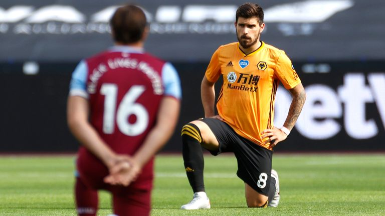 Ruben Neves takes a knee in support of the Black Lives Matter movement