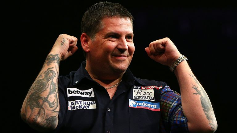 Gary Anderson of Scotland celebrates winning the Final against Michael van Gerwen of Holland during the Betway Premier League at The 02 Arena on May 21, 2015 in London, England.