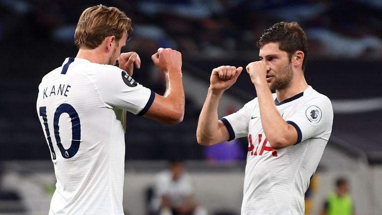 Harry Kane celebrates scoring with Ben Davies for Spurs against West Ham